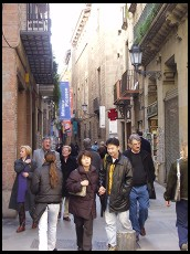 Digital photo titled old-city-tourists-in-narrow-street