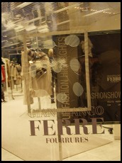 Digital photo titled smashed-window-at-ferre-fur-shop-on-bahnhofstrasse-zurich