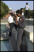 Digital photo titled guard-taking-photo-at-taj-mahal
