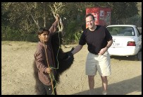 Digital photo titled philip-shaking-hands-with-roadside-bear