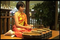 Digital photo titled girl-playing-traditional-music