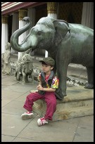 Digital photo titled kid-and-elephant-statue