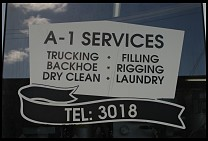 Digital photo titled backhoe-and-laundry