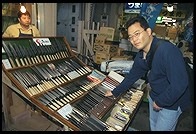 Jin shopping for knives at the Tsukiji Market.  Tokyo