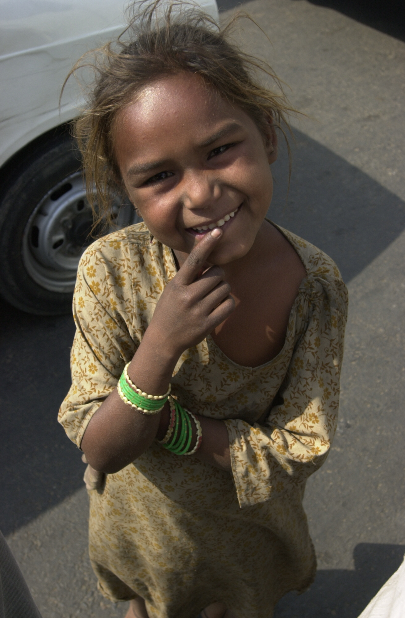 http://philip.greenspun.com/images/200103-d1-delhi/red-fort-beggar-girl.jpg