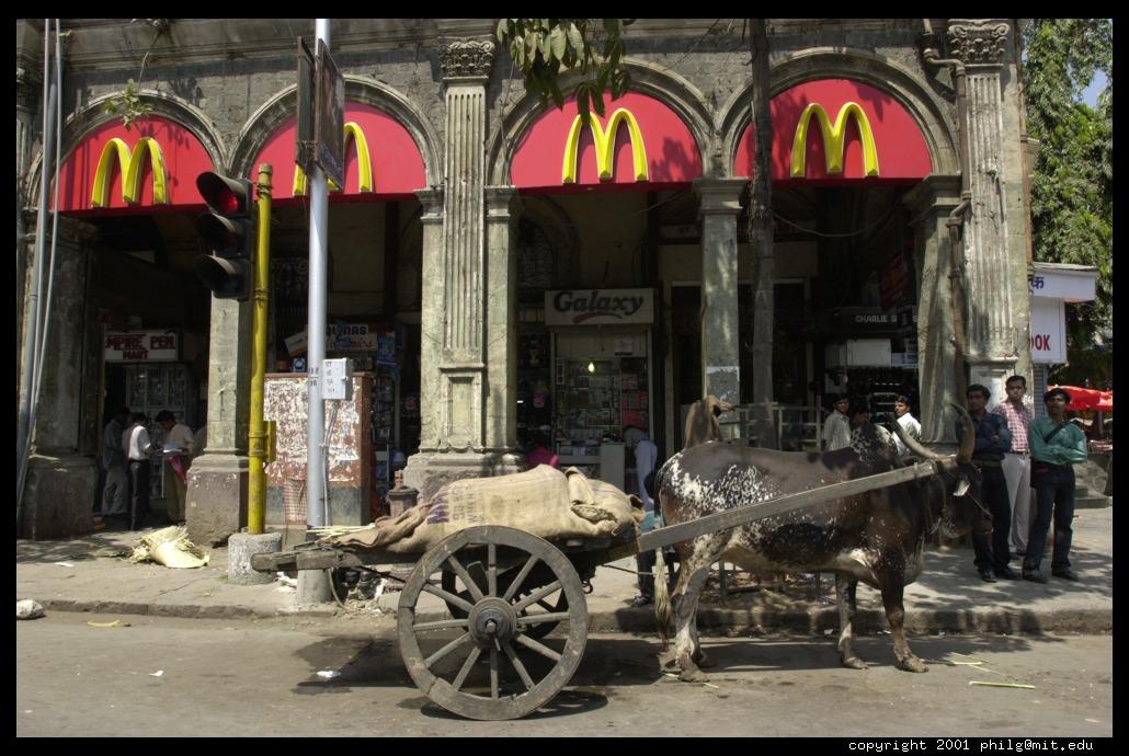 http://philip.greenspun.com/images/200103-d1-mumbai/animal-power-and-mcdonalds.half.jpg