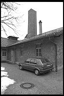 VW Golf parked next to Krematorium.  Dachau Concentration Camp.  Just outside Munich, Germany