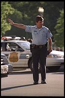 Traffic cop trying to untangle the perpetual traffic jam created in Washington, D.C.  by Bill Clinton's closure of Pennsylvania Avenue to traffic by commoners.