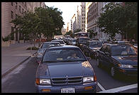 Traffic Jam.  Washington, D.C.  In 1995, Bill Clinton closed Pennsylvania Avenue to traffic by commoners.  Hence residents of Washington, D.C. are forced to fight their way through traffic to get around the White House.