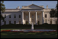 The White House.  Washington, D.C.  This is the photo that you can get by poking your camera through the iron fence rails.