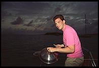 Harry Greenspun cooks.  Stern of the Diane.  Caribbean.