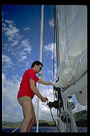 My brother Harry fiddles with the sails on the Diana