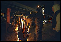 Staying warm around the fire, outside the Fulton Fish Market.  Manhattan 1994 (pre burning).