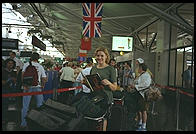 Eve standing in British Airways in Boston airport, heading for Stockholm