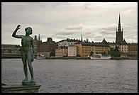 Statue near Stadshuset in Stockholm.  Gamla Stan (Old Town) is in the background.