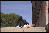 Sleeping person in Gamla Stan in central Stockholm