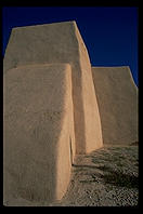 The famous back of the adobe church in Ranchos de Taos.  New Mexico