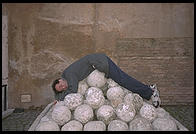 Cannon balls stacked up inside Castel Sant'Angelo (and me)