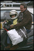 Father and son out Christmas shopping on a moped (Rome)