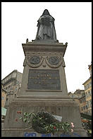 Smack in the center of the Campo de Fiori (Rome) is a statue of Giordano Bruno, philosopher.  Bruno held that God was present in nature and that the universe was infinite.  The Catholic Church burned him at the stake in 1600, right where his statue is today.