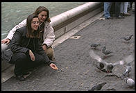 Girls feeding pigeons at the Fontana di Trevi