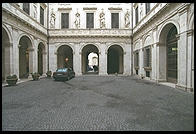 Palazzo Spada, near Rome's Campo de Fiori.  This was built in 1540 for a cardinal and improved by Cardinal Bernardino Spara and his brother Virginio in the 17th century.  They assembled a big art collection which is open to the public and hired Borromini to construct a clever gallery that appears longer than it is due to successively shortened columns.