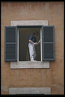 A house painter at work in an older quarter of Rome