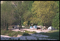 Homeless camp in the river.  Downtown Munich next to Deutsches Museum.