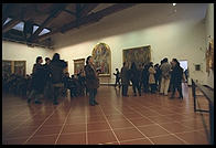 The tour groups at the Uffizi mill about the Botticellis