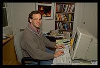Philip sitting at his Windows NT box (photo: Rob Silvers)