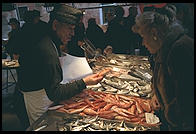 Fishmonger and customer in Venice's Rialto Markets