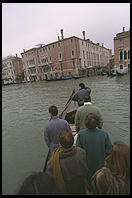 People standing up in the Traghetto Gondola, a micro-ferry service that crosses the Grand Canal at seven points.  These cost about 50 cents and hence are by far the cheapest way to get a gondola ride.  You're a sissy if you sit down.