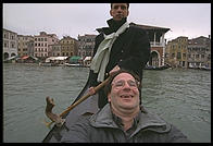 A Traghetto Gondolier and an incredibly fat American with a triple chin