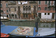 Everything goes in a boat in Venice, including a lot of big oil paintings.