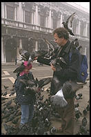 Father, Son, and Pigeons, an old combination in Venice's Piazza San Marco