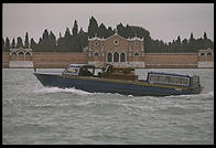 A hearse carries a Venetian to his grave on the lagoon island of San Michele.