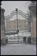A villa's gates in a light snowfall in Vicenza, Italy.