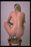 Nude on chair.
