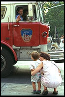 Kid and fire engine.  Outside French Roast, 6th Avenue and 11th, Manhattan 1995.