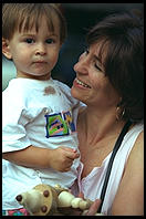 Kid and mom.  Outside French Roast, 6th Avenue and 11th, Manhattan 1995.