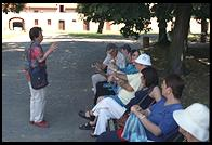 Irena Ravel (Theresienstadt survivor) guiding a tour group.  Small Fortress.  Terezin