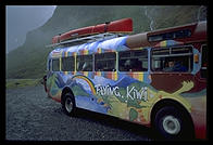 A Flying Kiwi tour bus on its way over the pass to Milford Sound.  South Island, New Zealand.
