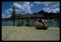 Philip on rock on front of lake in the Sierra Nevada.