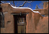 Adboe house and snow.  Santa Fe, New Mexico