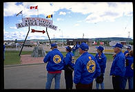 Members of an RV caravan contemplate the beginning of the Alaska Highway.  Dawson Creek, British Columbia.