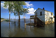 A house with a moat, courtesy of the flooded Mississippi River.  Near St. Charles, Missouri in 1993.