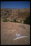 A warning sign on the Slickrock Trail as it runs along the rim of Negro Bill Canyon.  Moab, Utah.