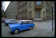 A Trabbi next to a Berlin street named after the town where V2 rockets were made