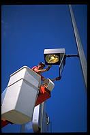Workers cleaning the mud out of a street light in St. Louis, Missouri.  The Mississippi rose high enough to fill hundreds of street lights with mud.