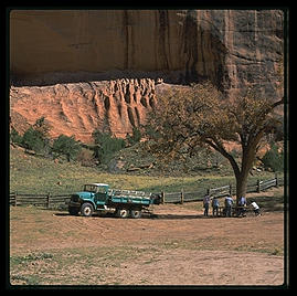 Canyon de Chelly (northeast Arizona).  The only legal way to see most of the canyon is with a Navajo guide.  Here is a typical group of tourists on a truck-based tour of the canyon.